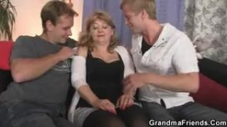 Older mom enjoys two cocks in mouth and pussy